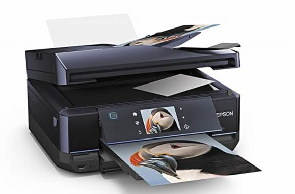 The unit even has a caddy for printing on specially coated CD and DVD media, though the software and documentation can be confusing.
