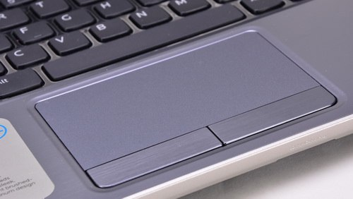 The touchpad is wide, supporting multi-touch.