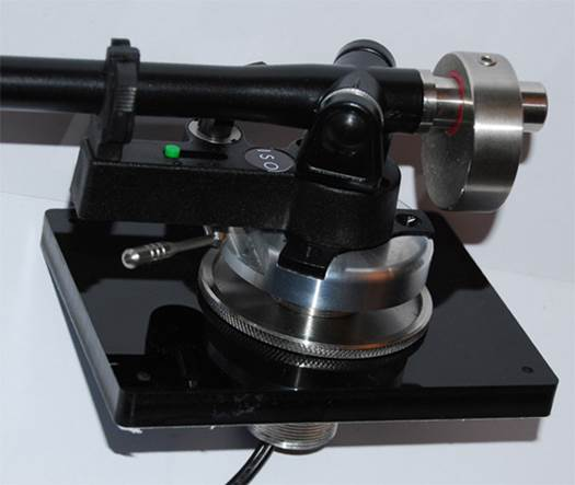 This allows the user to fit almost any tonearm to the turntable